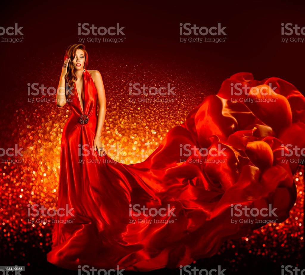 Fashion Woman Red Dress, Beauty Model Gown Flying Silk Fabric stock photo