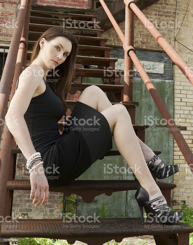Fashion woman sitting on steps. royalty-free stock photo