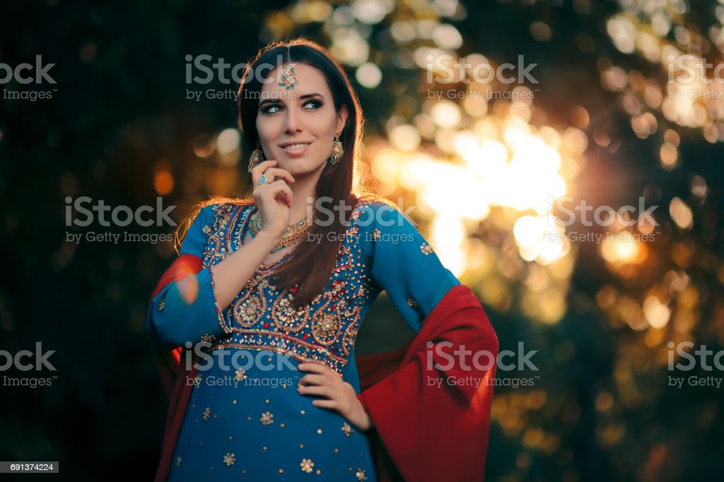 Fashion Woman Wearing Indian Costume and Jewelry Set stock photo