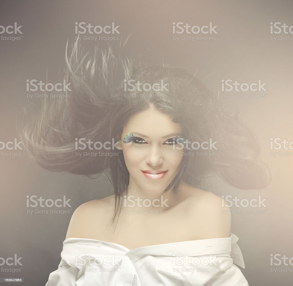 fashion woman with flying hair royalty-free stock photo