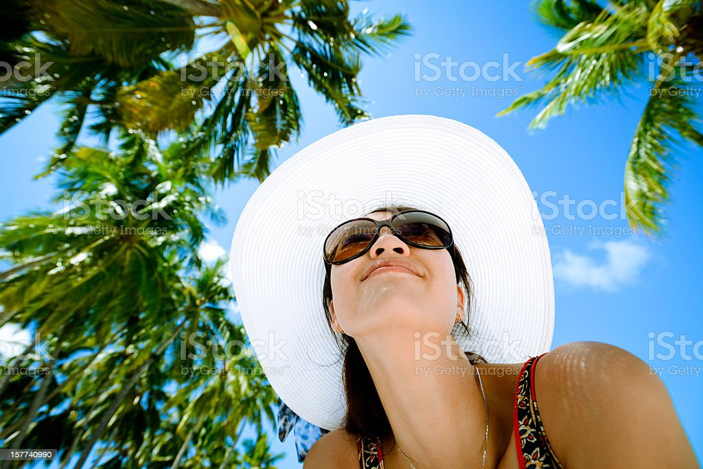 Fashion Woman With Palm Tree Background stock photo