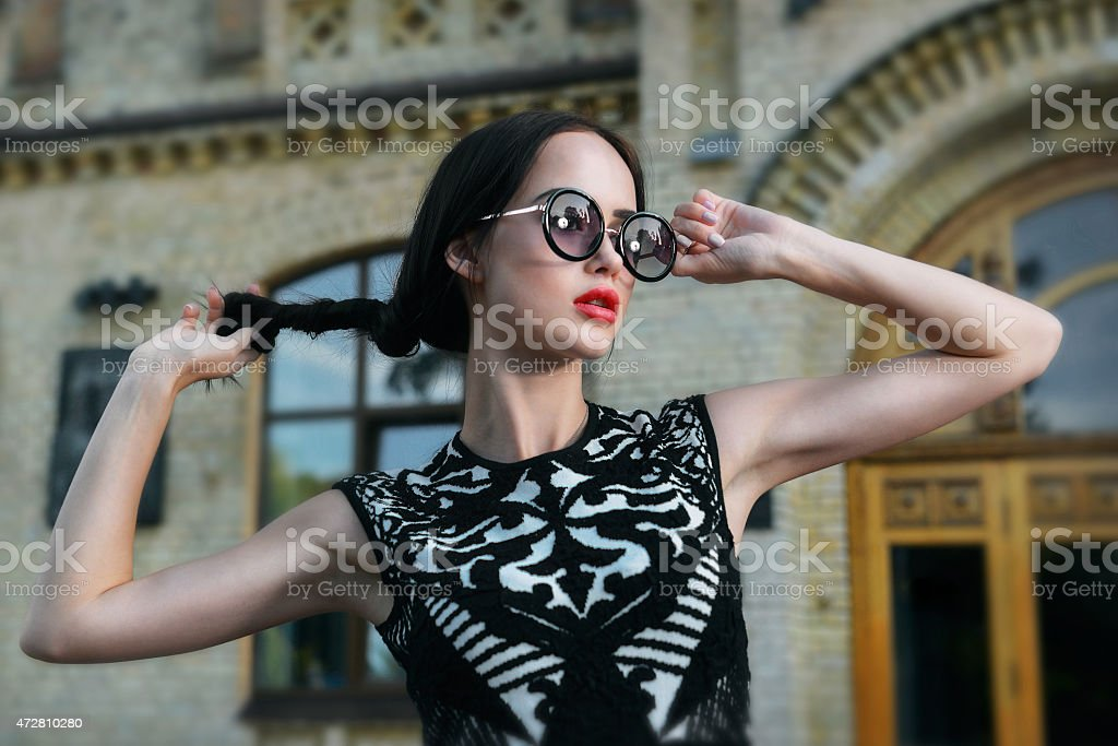 Fashion woman with red lips in sunglasses stock photo