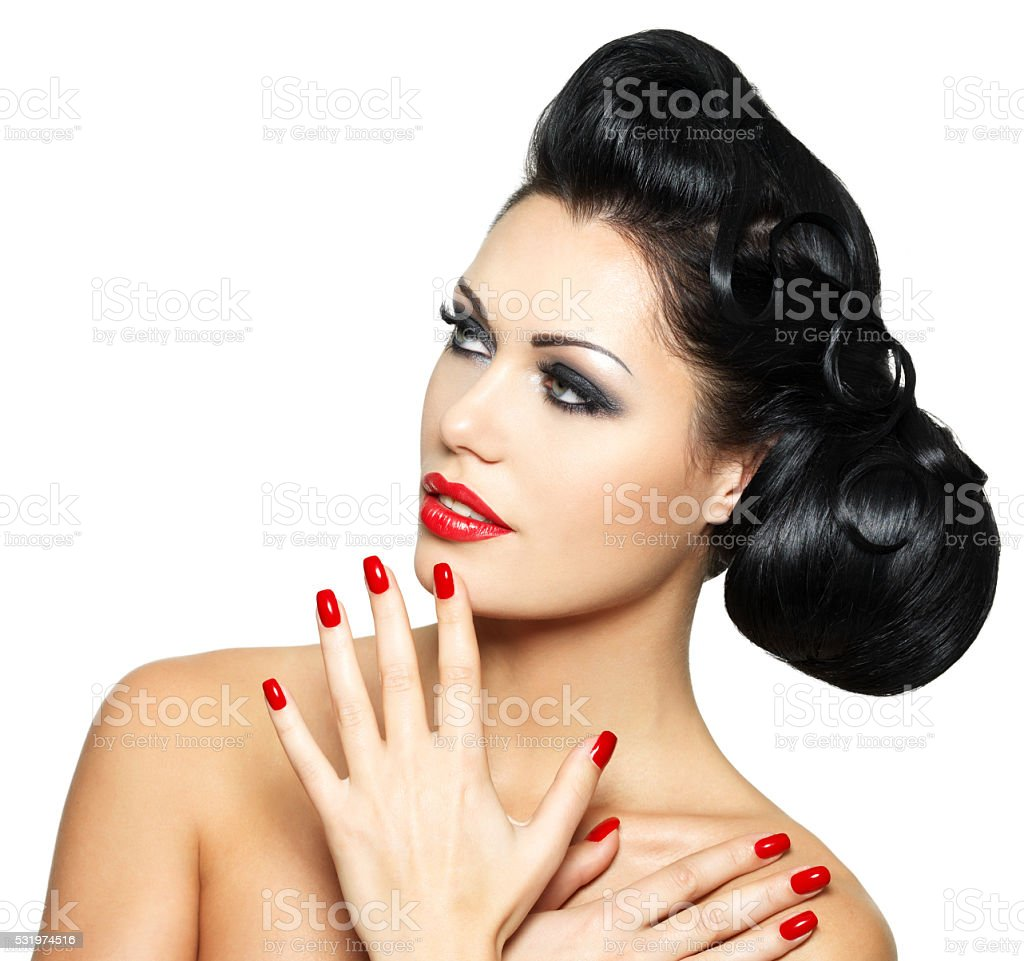 fashion woman with red lips, nails and creative hairstyle stock photo