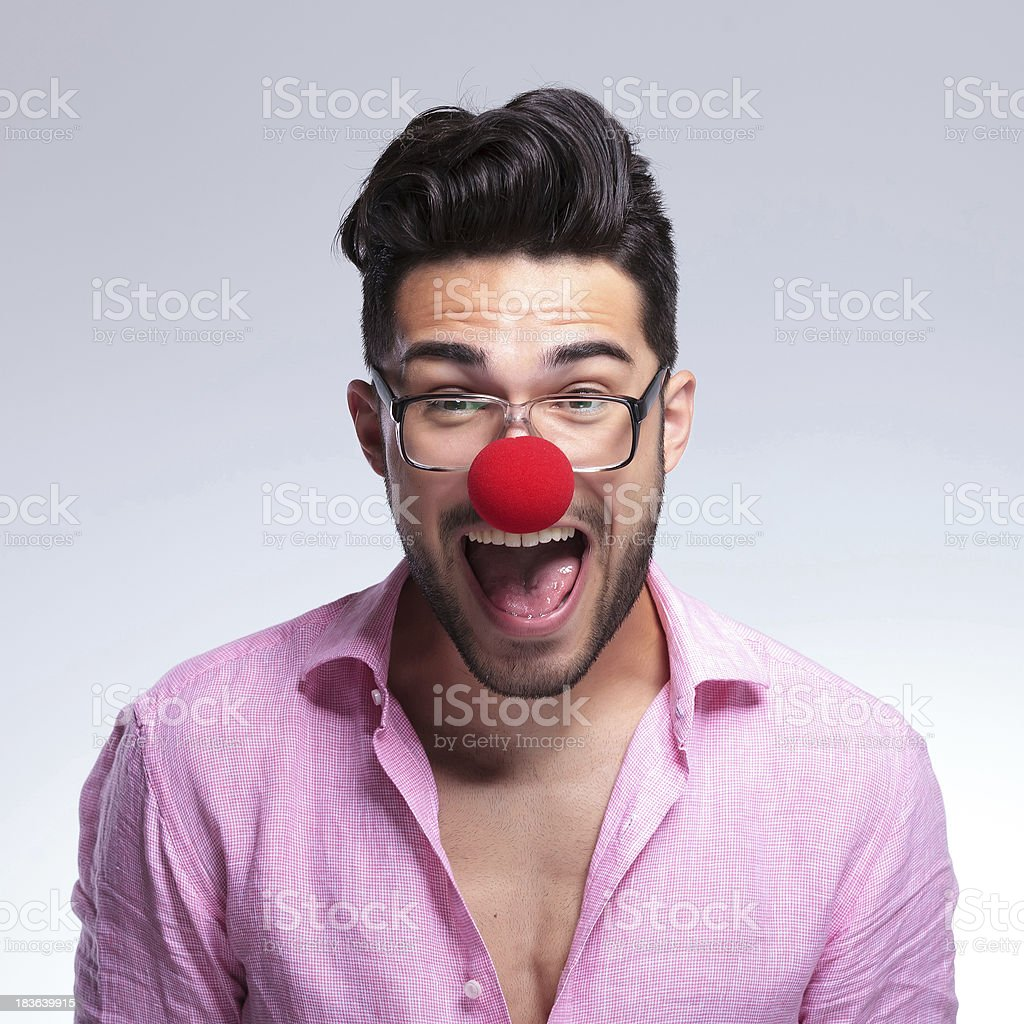 fashion young man shouts with a red nose stock photo