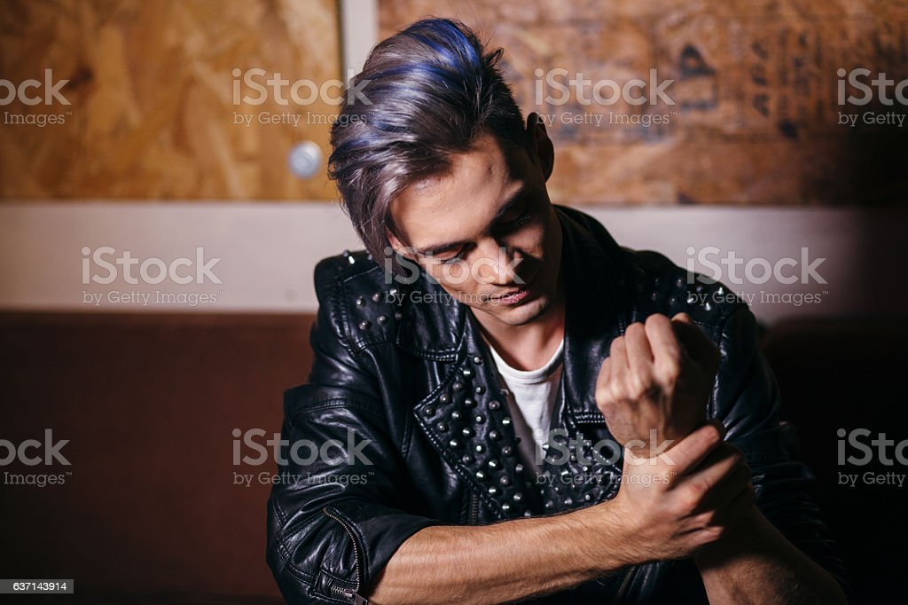 Fashion young model man portrait. Handsome Guy. Hairstyle stock photo