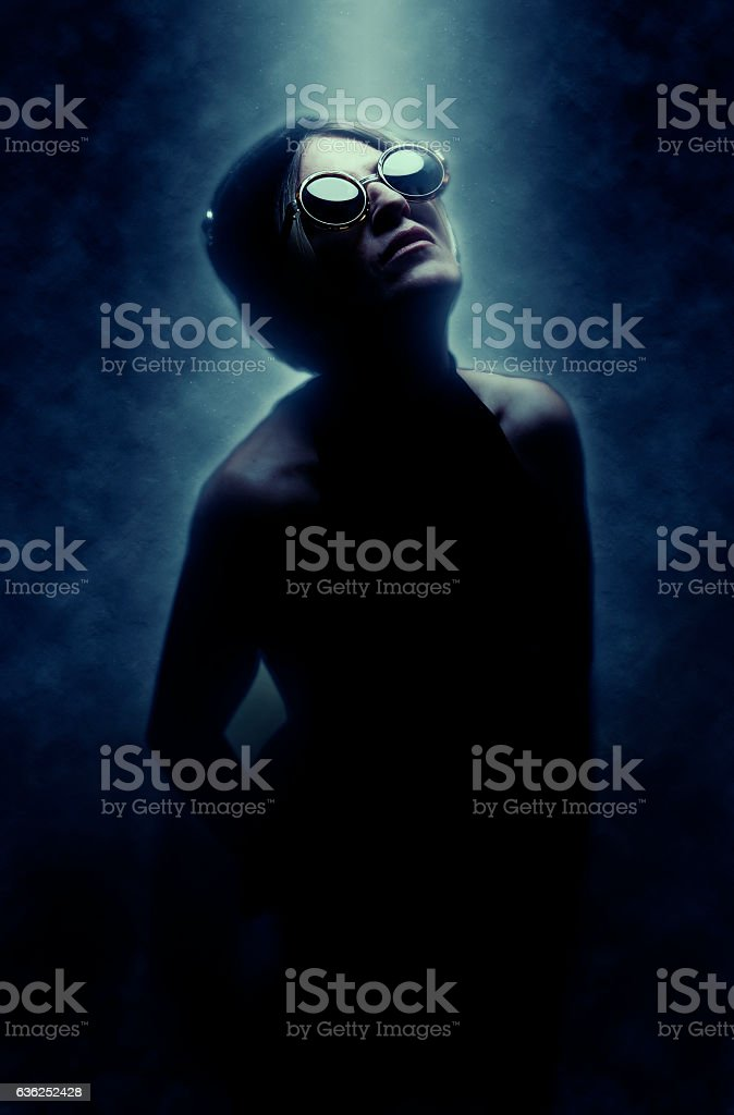 Fashionable Adult Woman Looking Into the Light stock photo