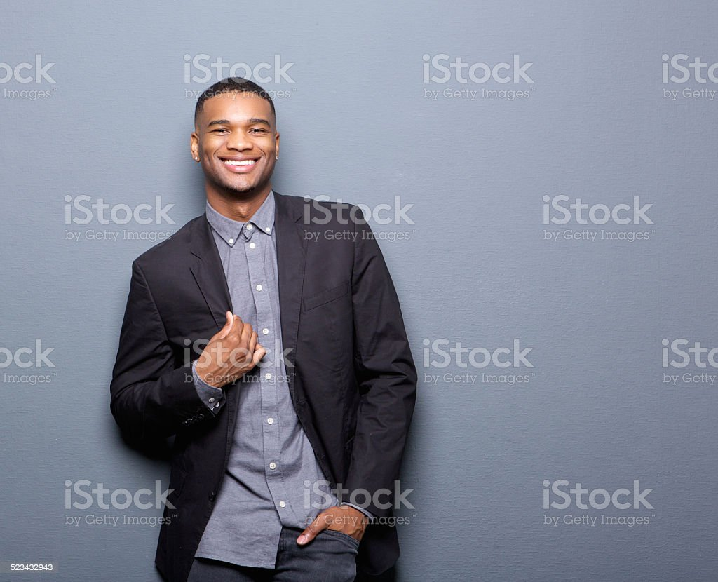 Fashionable african american man smiling stock photo