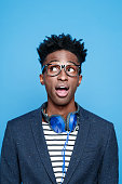 Fashionable afro american young man against blue background