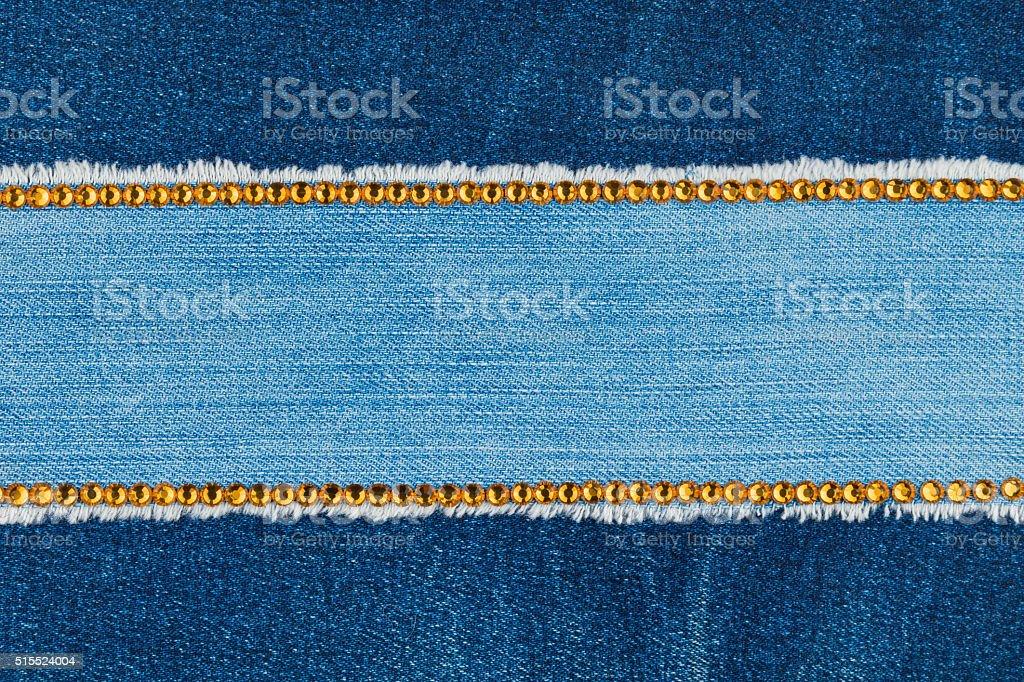 Fashionable background,  jeans and yellow  rhinestones stock photo