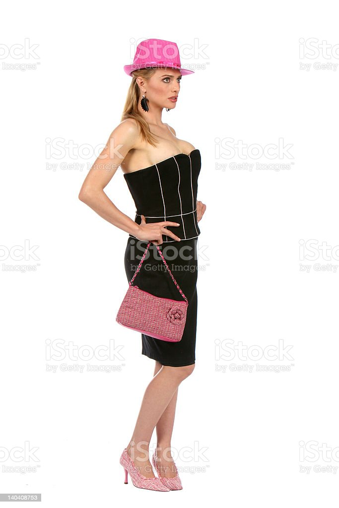 Fashionable blond in pink and black - isolated royalty-free stock photo