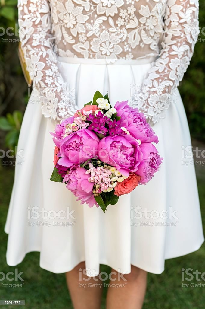 Fashionable bride & wedding bouquet stock photo