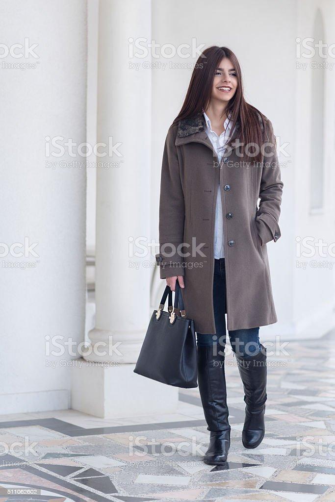 Fashionable Brunette Businesswomen Walking Outdoor on City Street stock photo