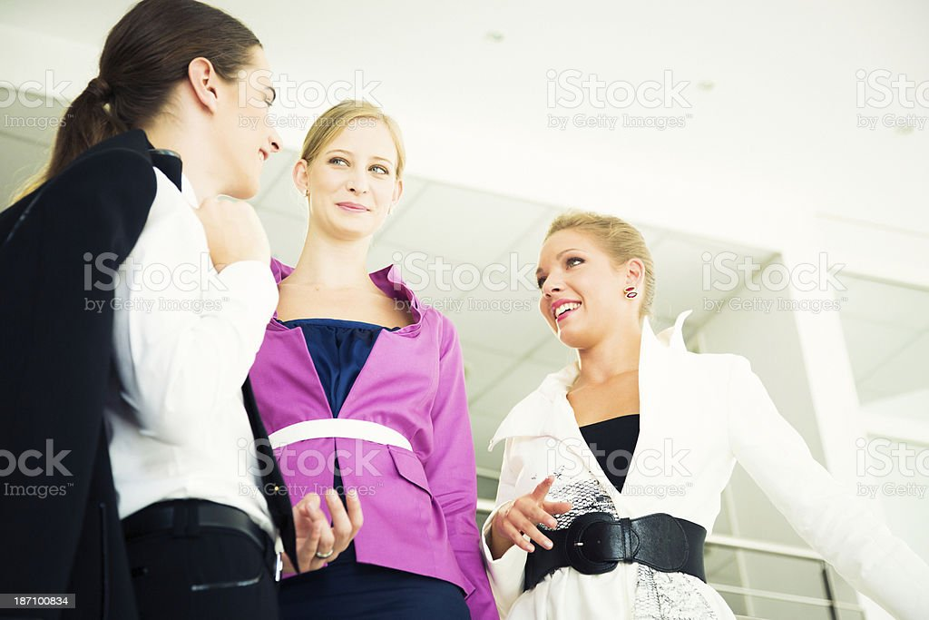 fashionable business people in modern office environment royalty-free stock photo