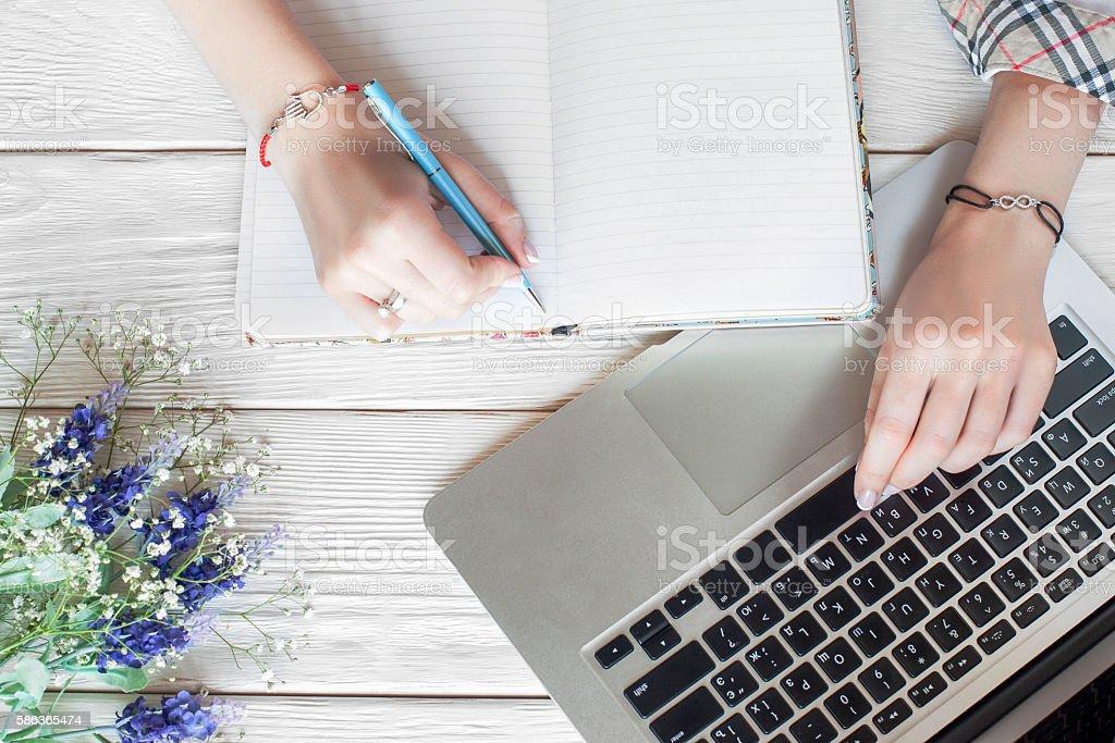 Fashionable business woman working with notebook stock photo