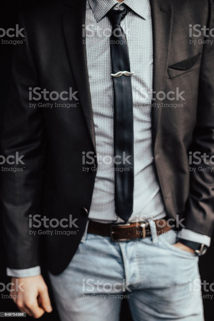 Fashionable businessman wearing tie clip in shape of a mustache stock photo