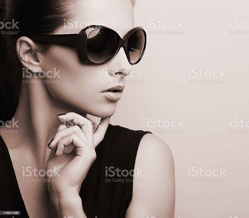 Fashionable chic female model profile in fashion sun glasses stock photo
