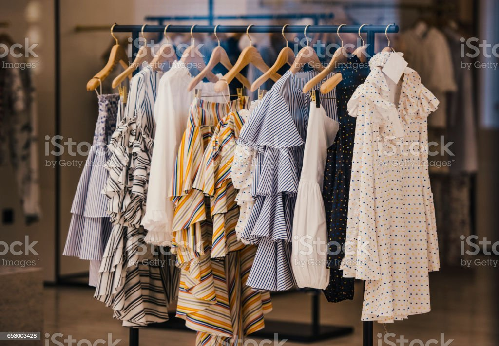 Fashionable clothes in a boutique store in London. stock photo