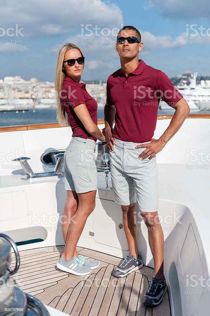 Fashionable cool couple on luxury yacht stock photo