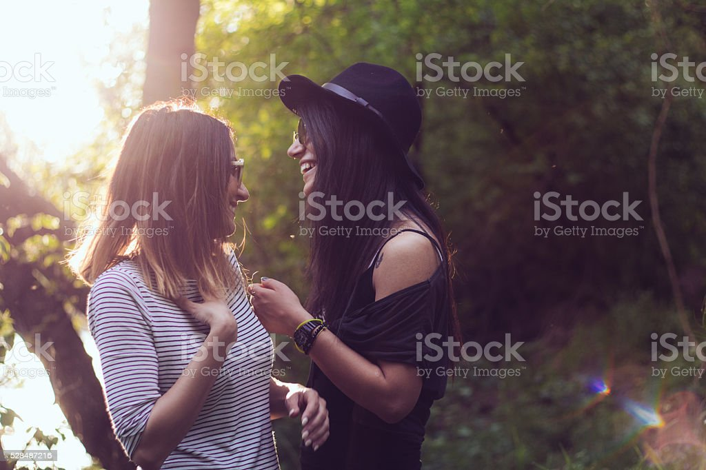 Fashionable gay girls giggling outdoor stock photo