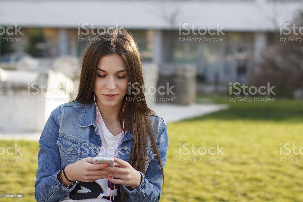 Fashionable girl listening music royalty-free stock photo