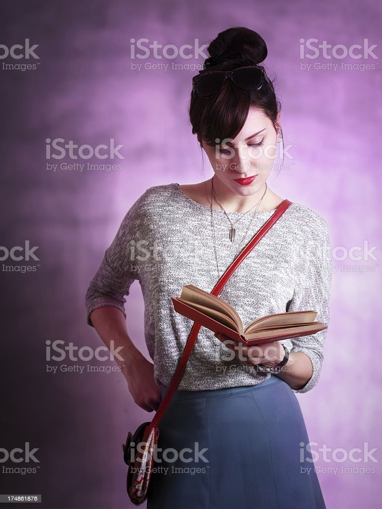 Fashionable girl reading a book royalty-free stock photo