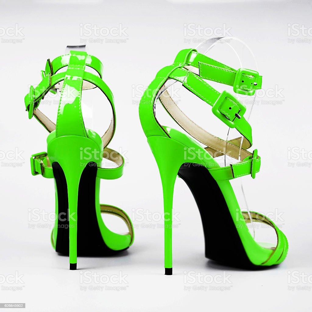 Fashionable green woman shoe on white background stock photo