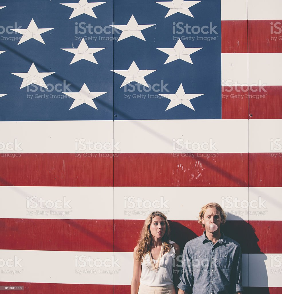 Fashionable hip couple in front of American flag New York stock photo