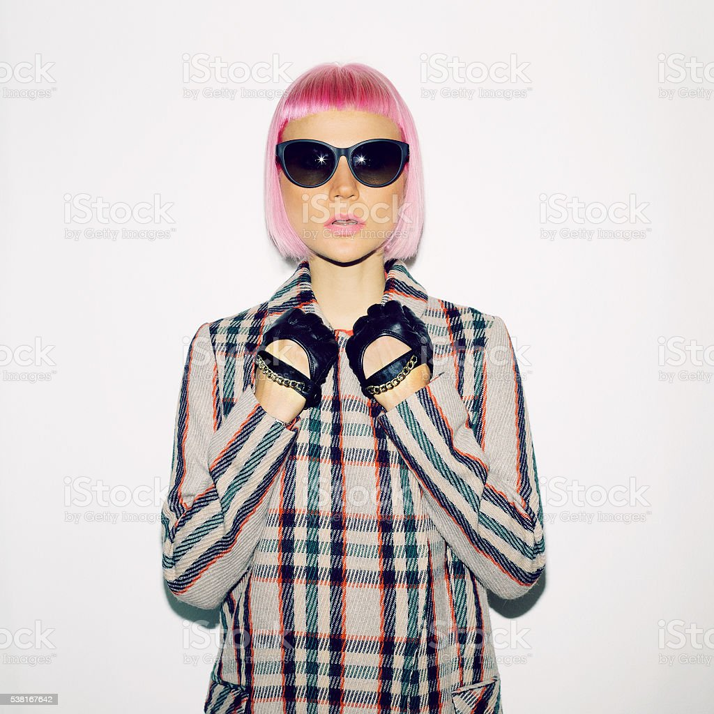 Fashionable Lady in checkered coat and pink hair stock photo