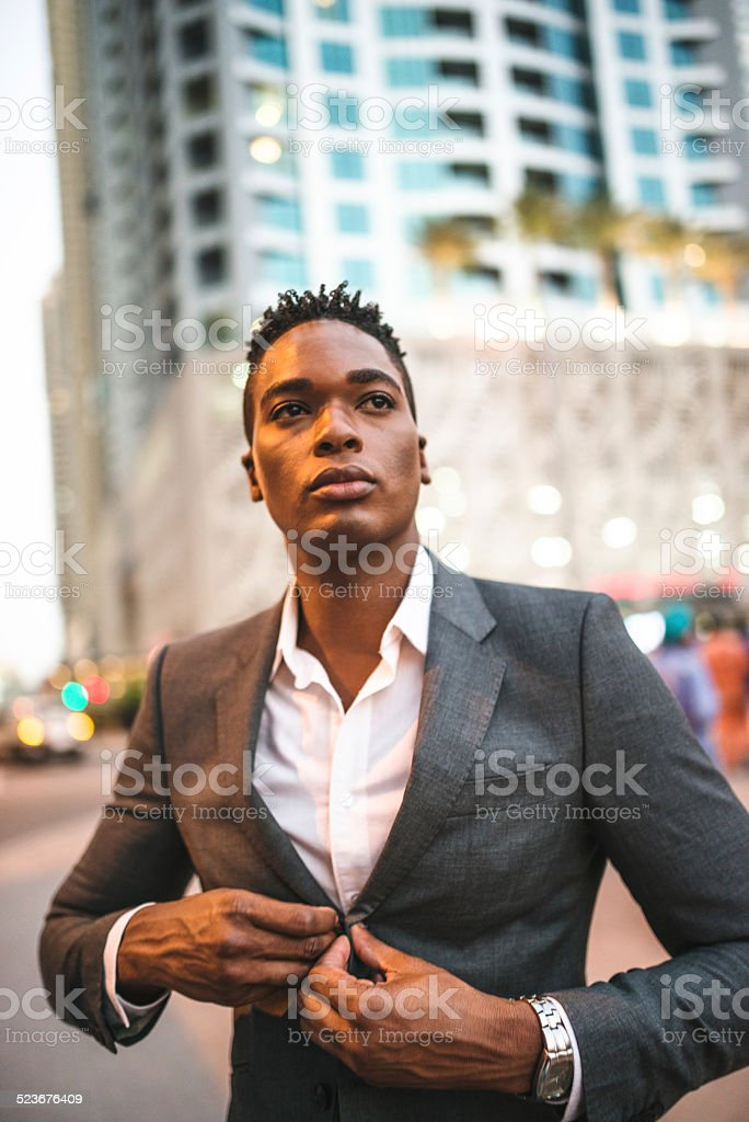 fashionable man posing on the city stock photo