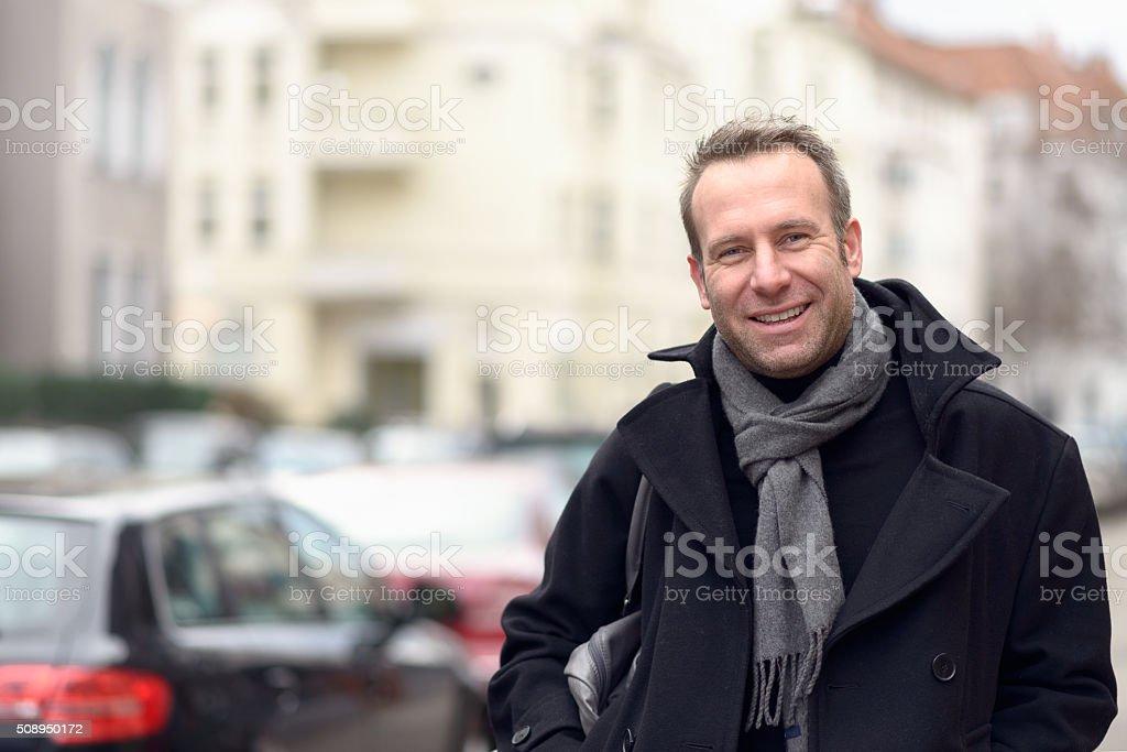 Fashionable man standing in an urban street stock photo