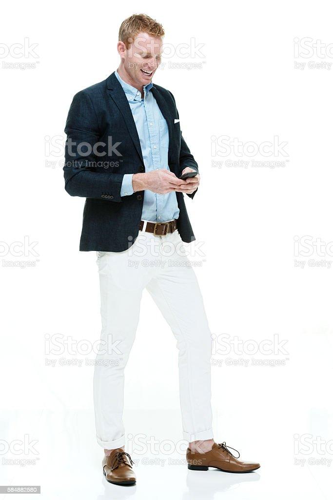 Fashionable man using phone stock photo