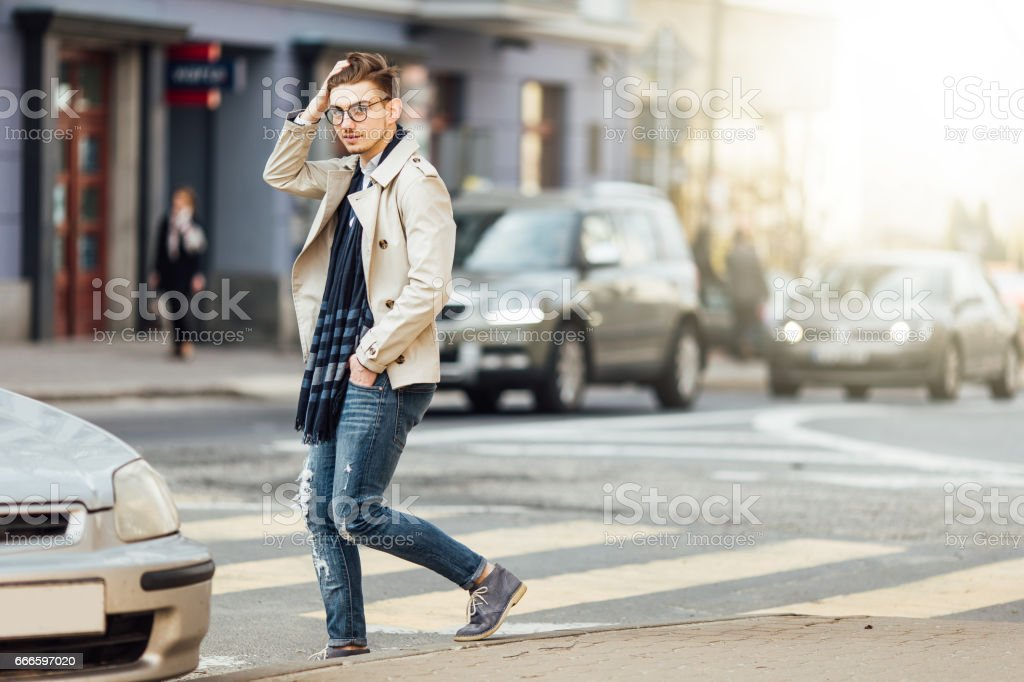 Fashionable man walking on the street with blur background stock photo