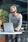 Fashionable Mature Businesswoman Working On Laptop