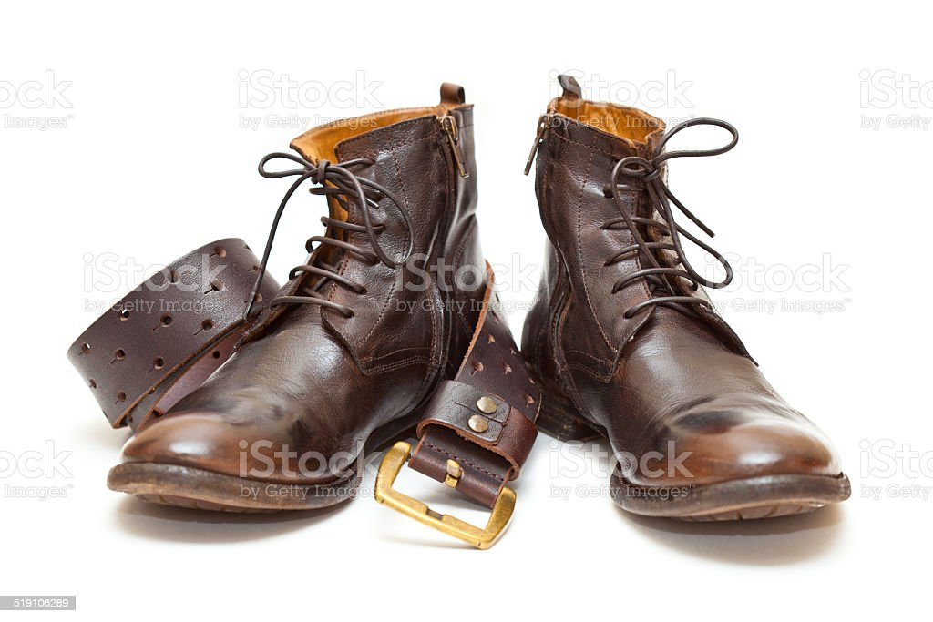 Fashionable men's leather shoes and leather belt with buckle stock photo