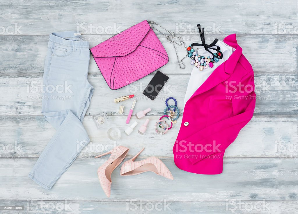 Fashionable outfit on the wooden floor stock photo