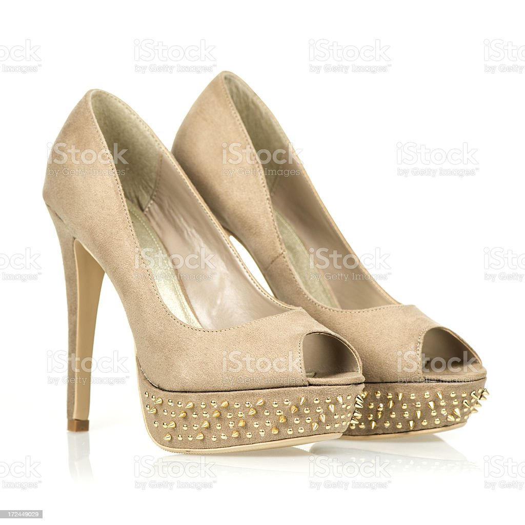Fashionable Peeptoe High Heels with golden spikes stock photo