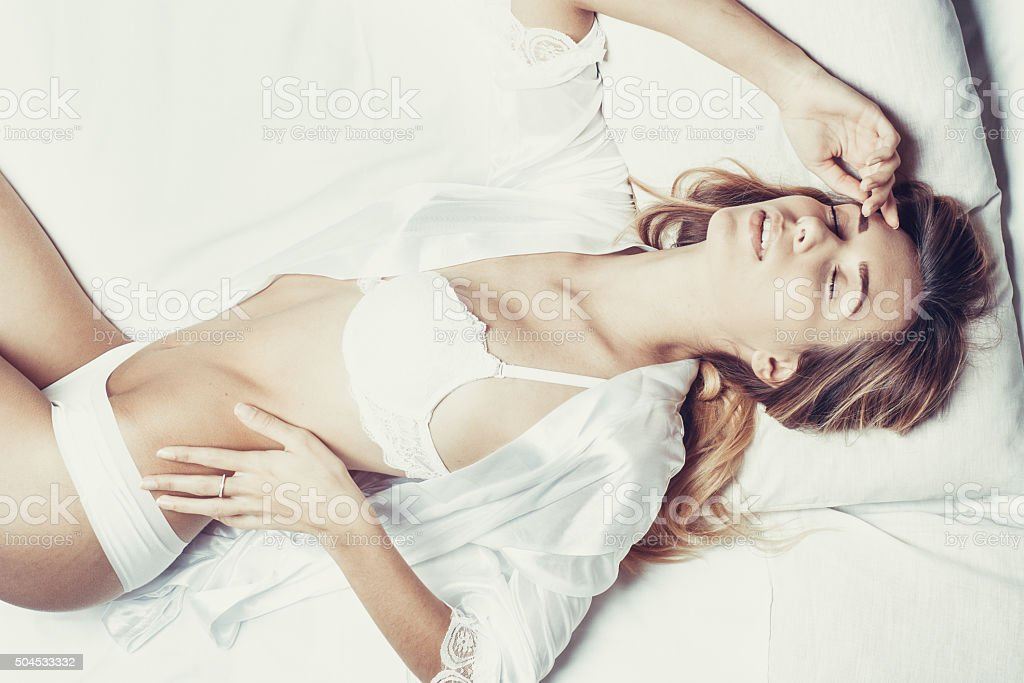 Fashionable photo of young sexy lady wearing white lingerie stock photo