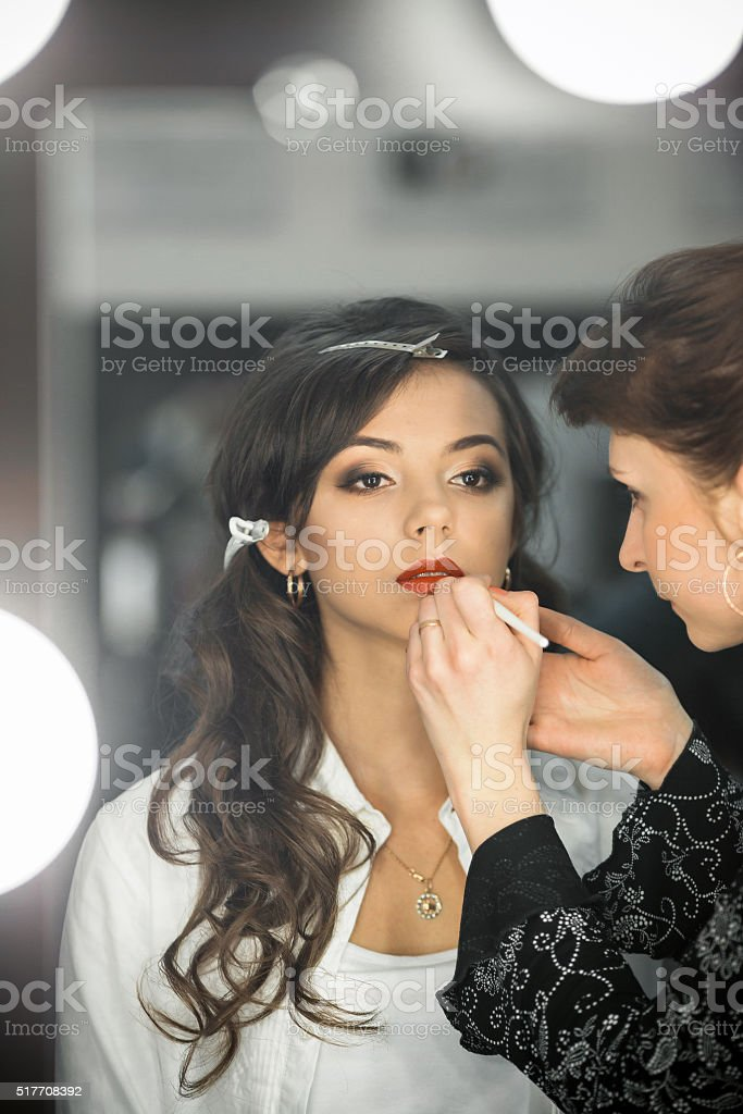 Fashionable professional model with seductive look,ideal skin, professional make-up stock photo