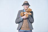 Fashionable senior with teddy bear