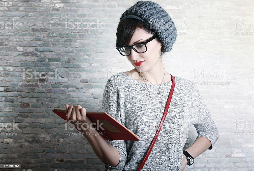 Fashionable student or professor reading a book royalty-free stock photo