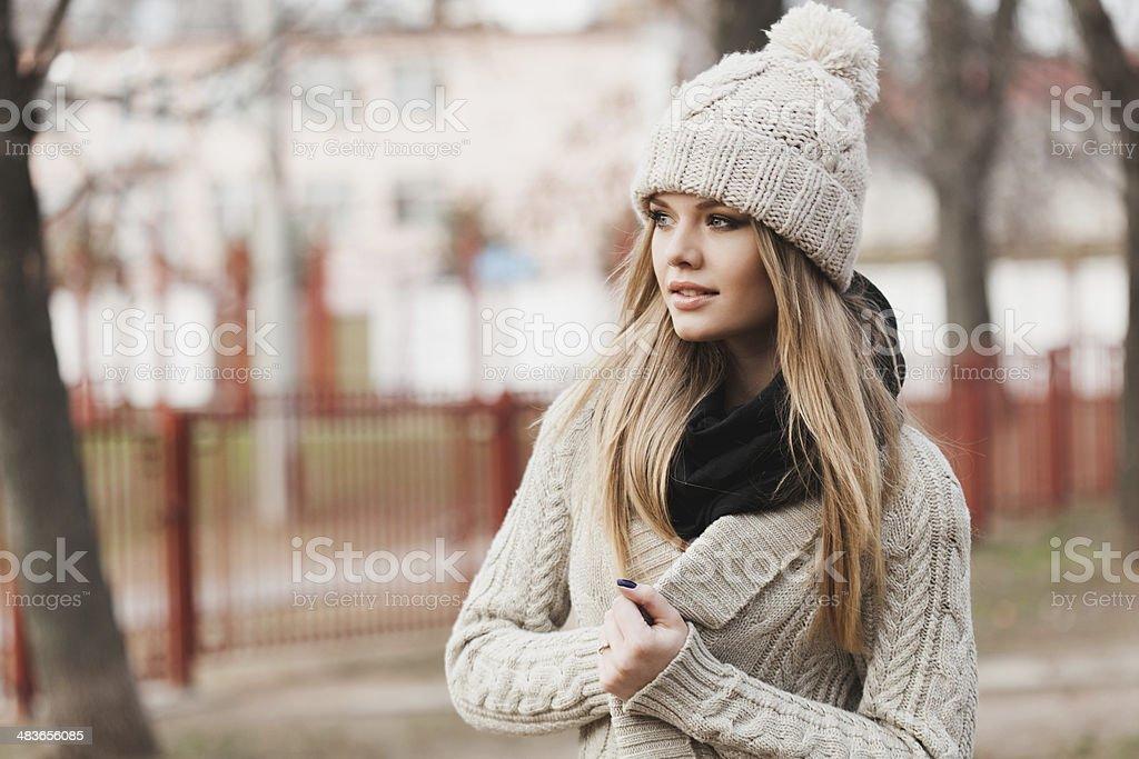 fashionable stylish girl in white knit jacket stock photo