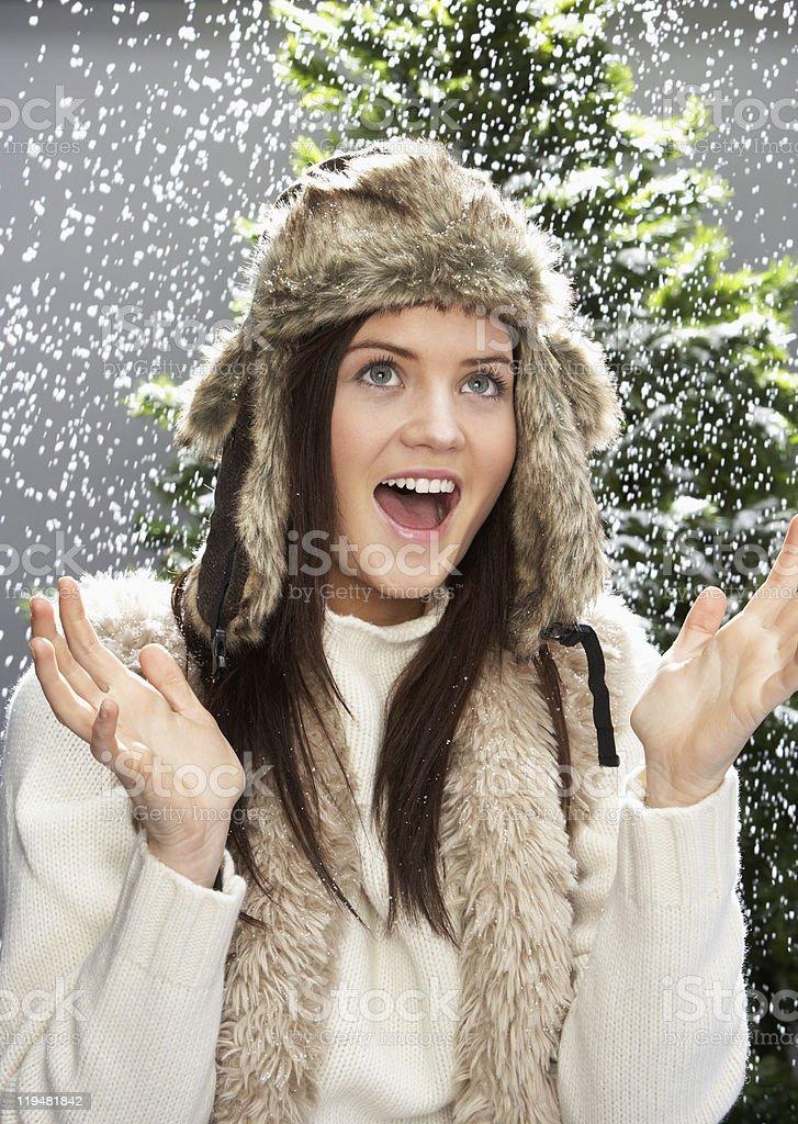 Fashionable Teenage Girl Wearing Cap And Knitwear In Studio royalty-free stock photo