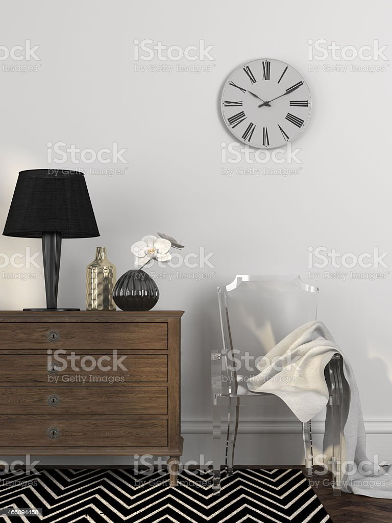 Fashionable transparent chair near the chest of drawers stock photo