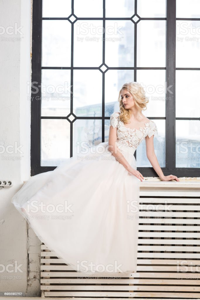 Fashionable Wedding Gown Beautiful Blonde Model Bride Hairstyle