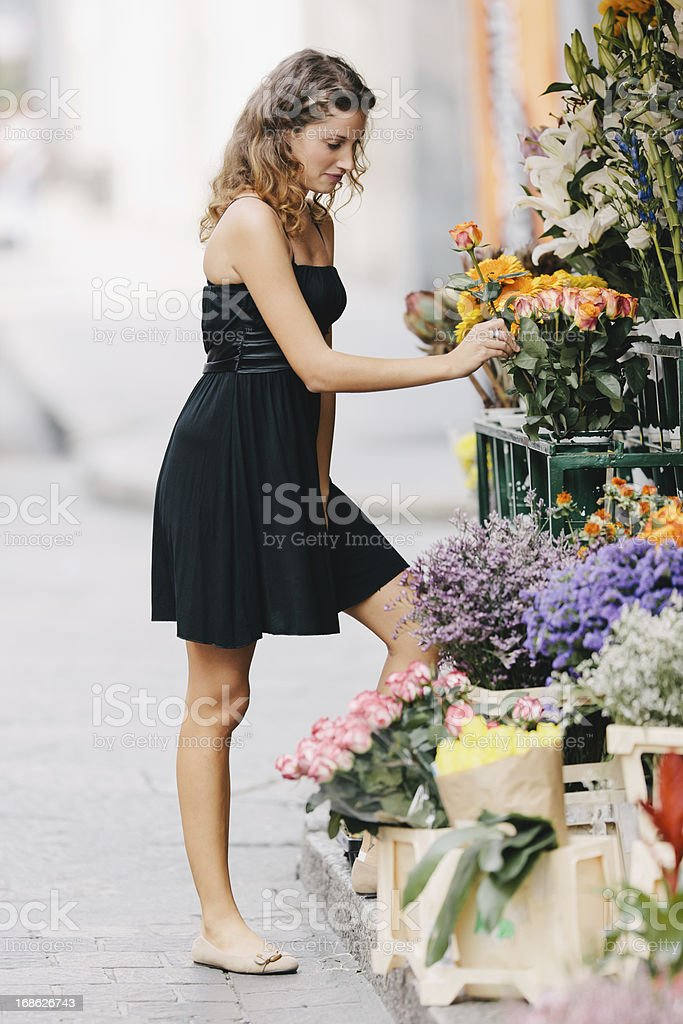 Fashionable woman at flower market royalty-free stock photo