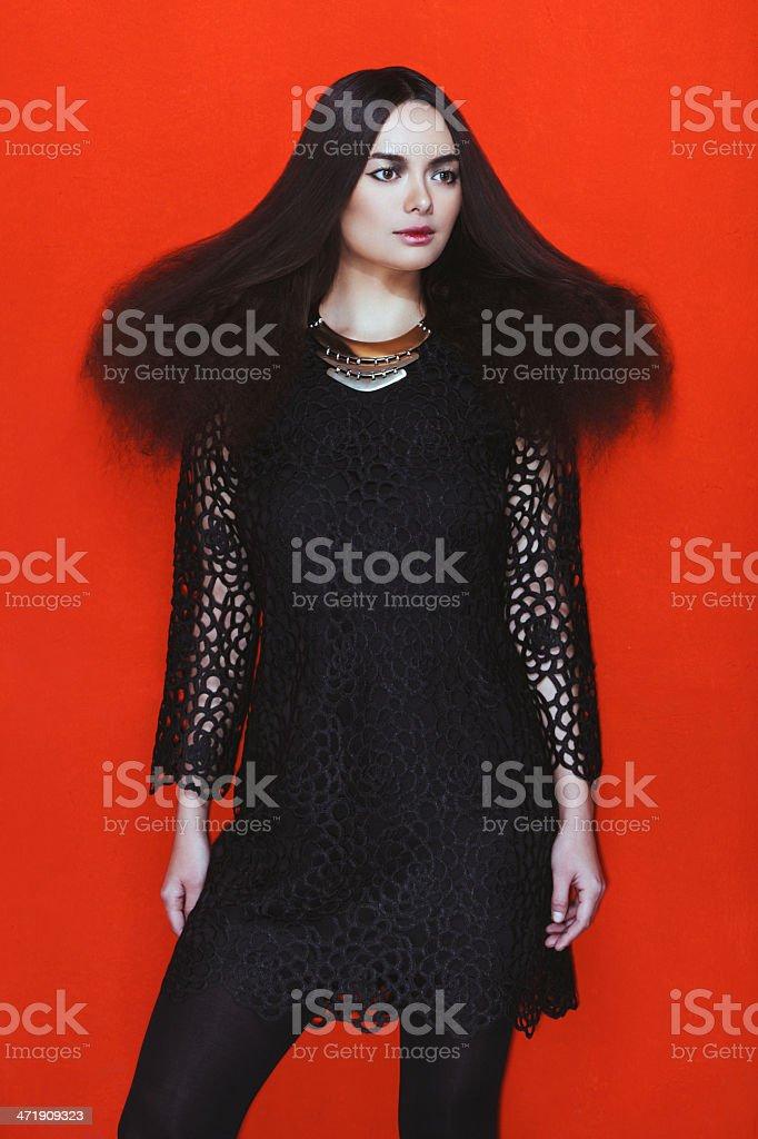 Fashionable woman in black dress stock photo