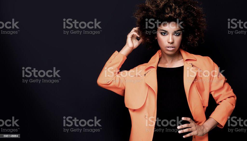 Fashionable woman in orange coat. stock photo