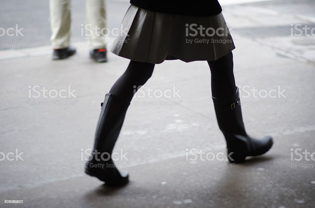 Fashionable Woman in Skirt and Boots stock photo