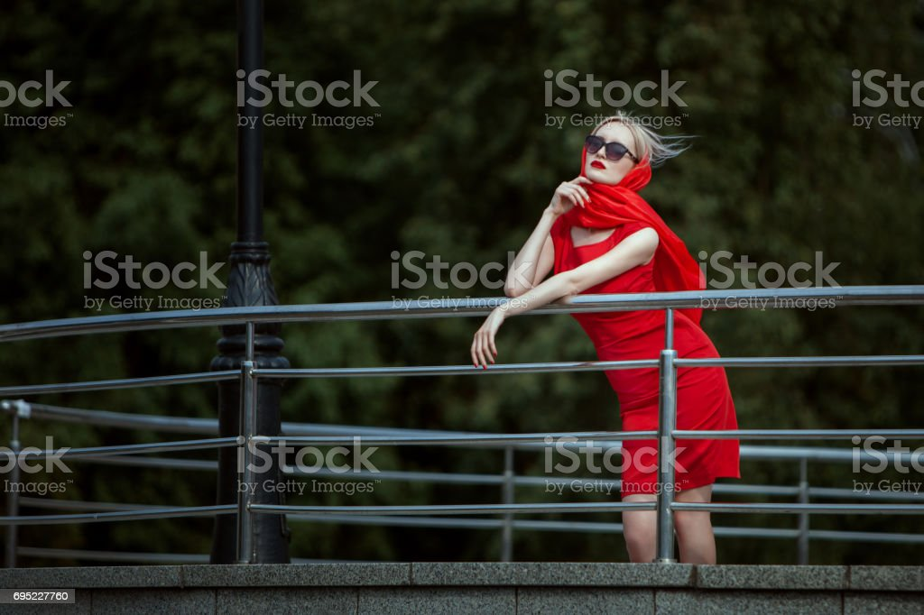 Fashionable woman is bored and waiting. stock photo