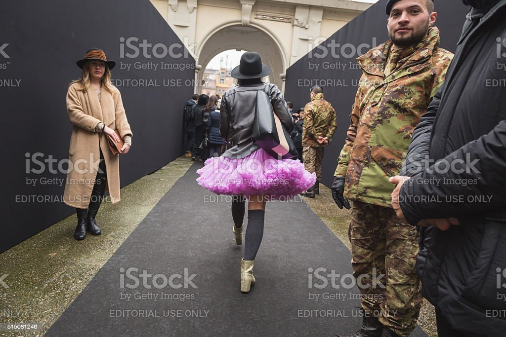 Fashionable woman outside Ermanno Scervino fashion show during M stock photo